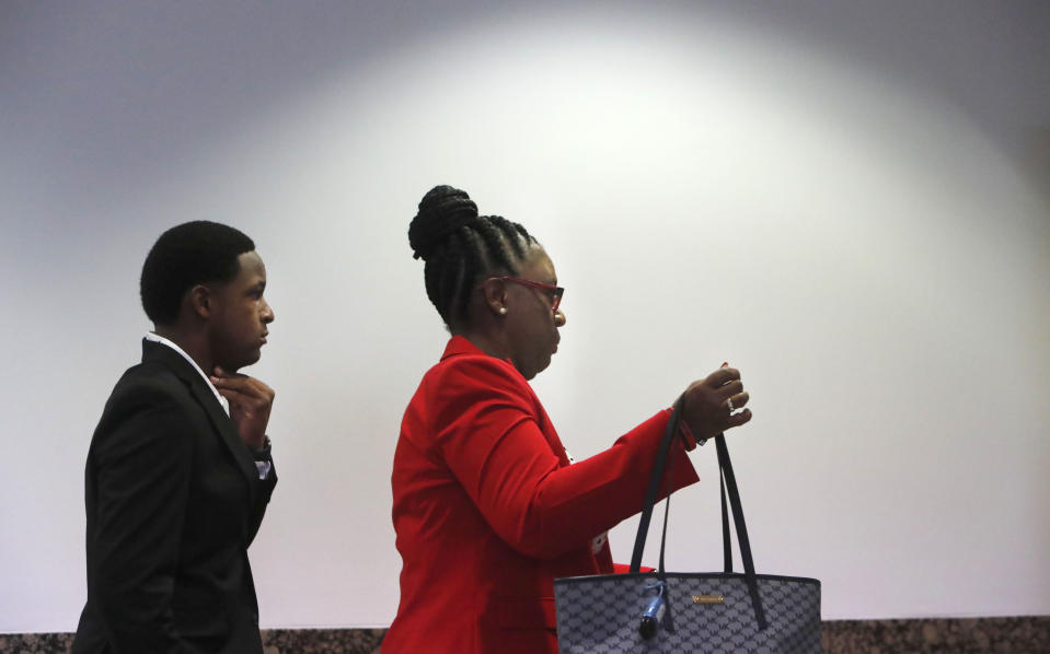 Allison Jean, right, the mother of Botham Jean and Botham's brother Brandt Jean arrive for the murder trial of former Dallas police Officer Amber Guyger in Dallas, Monday, Sept. 23, 2019. Guyger is on trial for shooting and killing her unarmed neighbor Botham Jean. (AP Photo/LM Otero)