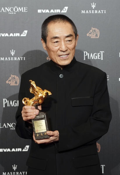 "Chinese director Zhang Yimou holds his award for Best Director at the 55th Golden Horse Awards in Taipei, Taiwan, Saturday, Nov. 17, 2018. Zhang won for the film ""Shadow"" at this year's Golden Horse Awards -the Chinese-language film industry's biggest annual events. (AP Photo/Billy Dai)"