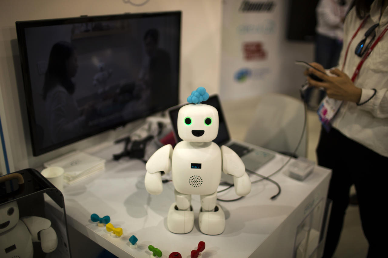 <p> Pibo robot, whose main purpose is getting you and your loved ones sharing your daily life again, receives instructions from her owner, at the Four Years From Now (FYFN) show, a sidebar event of Mobile World Congress in Barcelona, Spain, Monday, Feb. 27, 2017. While the latest smartphones presentations are all the rage at the Mobile World Congress, the under-the-radar event of the world's biggest wireless reunion is the Four Years From Now (FYFN) sideshow. It's where the new meets quirky and innovation knows no boundaries. (AP Photo/Emilio Morenatti) </p>