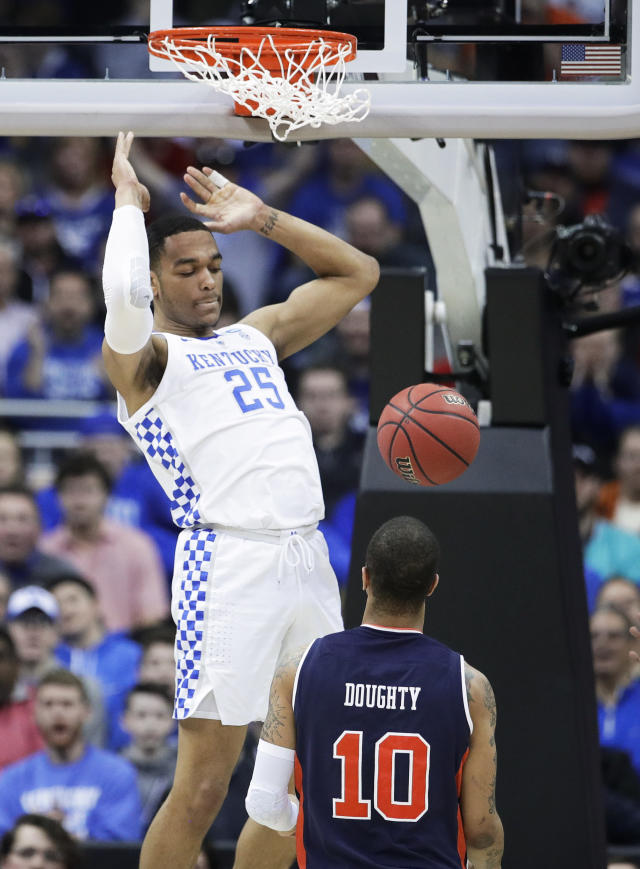 Kentucky's PJ Washington (25) dunks over Auburn's Samir Doughty (10) during the first half of the Midwest Regional final game in the NCAA men's college basketball tournament Sunday, March 31, 2019, in Kansas City, Mo. (AP Photo/Charlie Riedel)