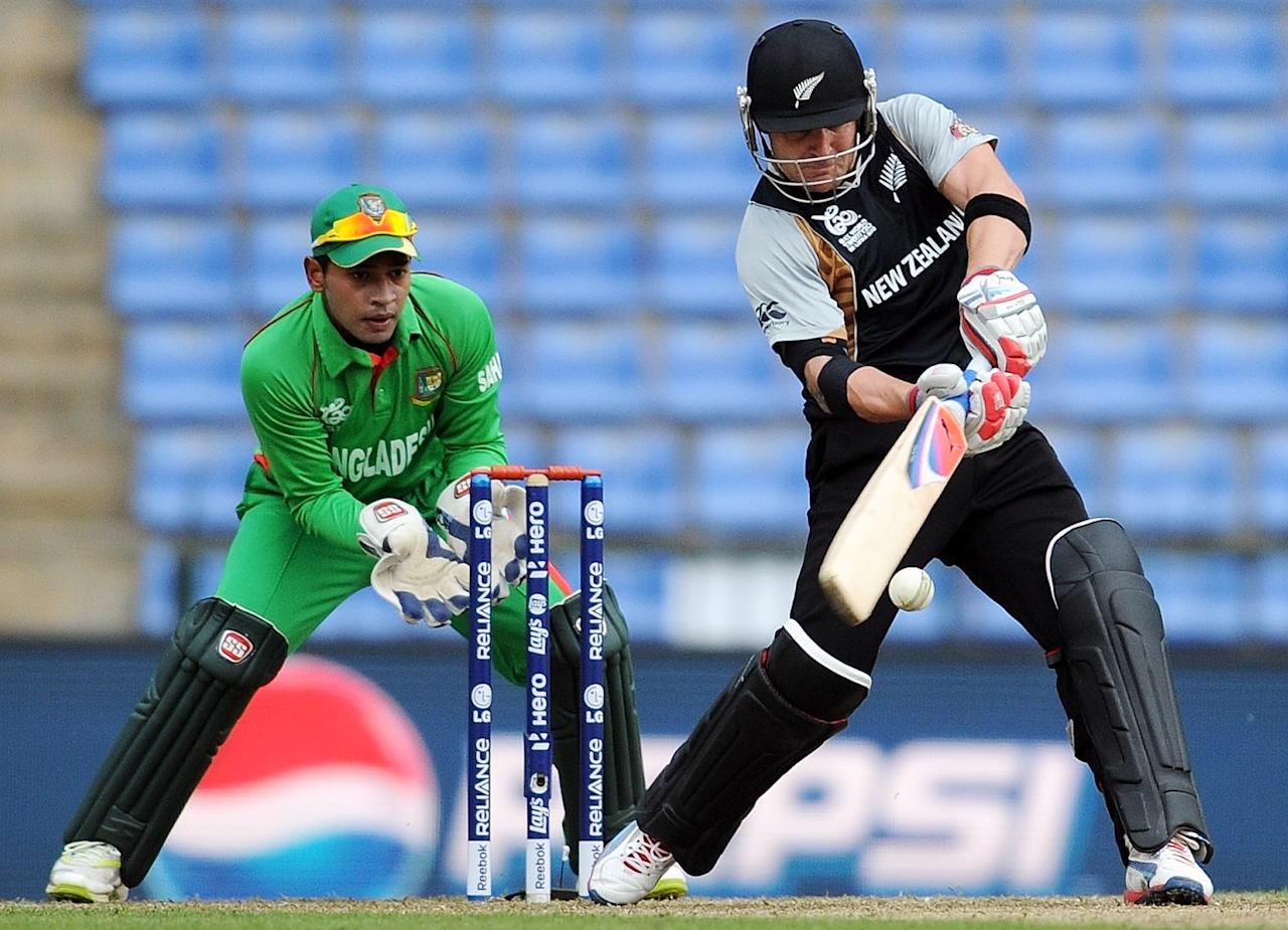 Bangladesh wicketkeeper captain Mushfiqur Rahim  (L) watches as New Zealand batsman Brendon McCullum plays a shot  during The ICC Twenty20 Cricket World Cup match between Bangladesh and New Zealand at The Pallekele International Cricket Stadium in Pallekele  on September 21, 2012.    AFP PHOTO/ Prakash SINGH