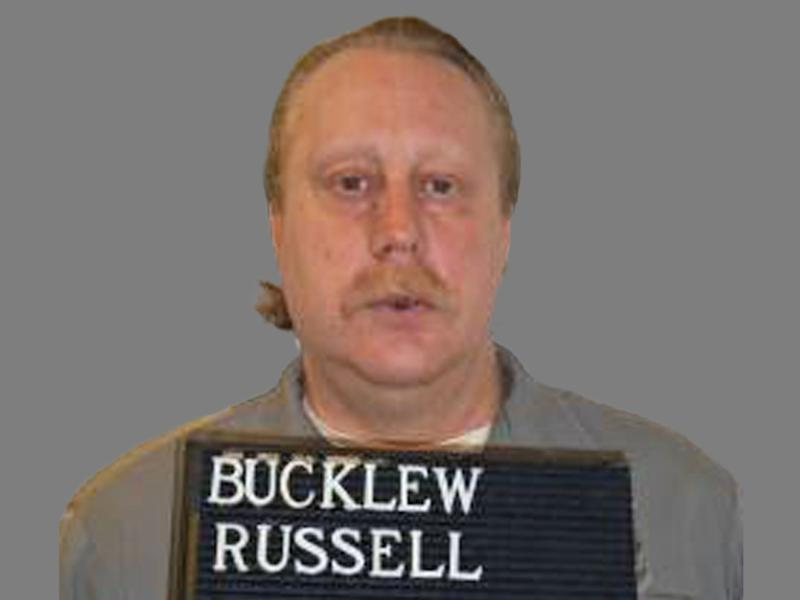 Russell Bucklew headshot, as Missouri death row inmate, Missouri Department of Corrections handout, graphic element on gray