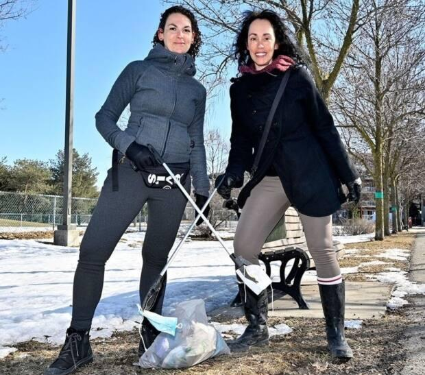 Elizabeth Barbosa, left, and Alcina Lopes have been friends for more than 40 years. They have been taking advantage of their weekly walks to clean the streets of Villeray of used surgical masks.  (Submitted by Elizabeth Barbosa - image credit)