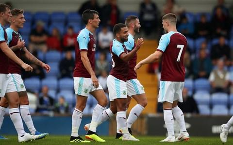 Burnley's Aaron Lennon celebrates with team-mates - Credit: Getty Images