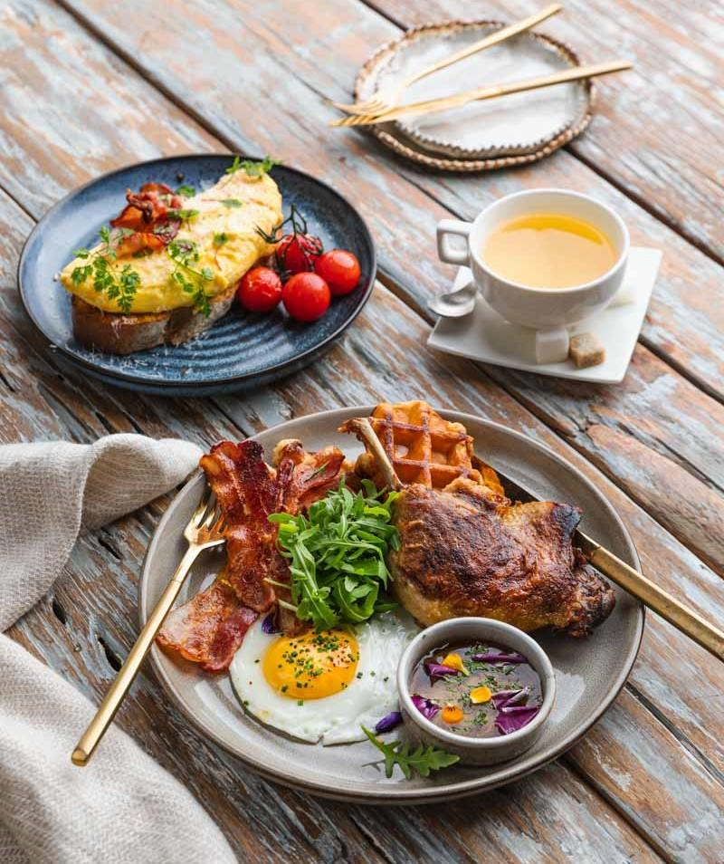 Duck & Waffle (front); Bacon & Cheese Omelette (back) (PHOTO: Poulet+)