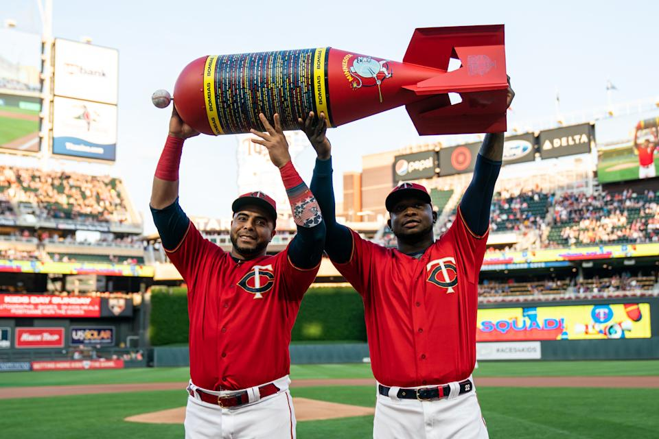 MINNEAPOLIS, MN - SEPTEMBER 06: Nelson Cruz #23 and Miguel Sano #22 of the Minnesota Twins are presented an award for setting the MLB single season home run record prior to the game against the Cleveland Indians on September 6, 2019 at the Target Field in Minneapolis, Minnesota. The Indians defeated the Twins 6-2. (Photo by Brace Hemmelgarn/Minnesota Twins/Getty Images)