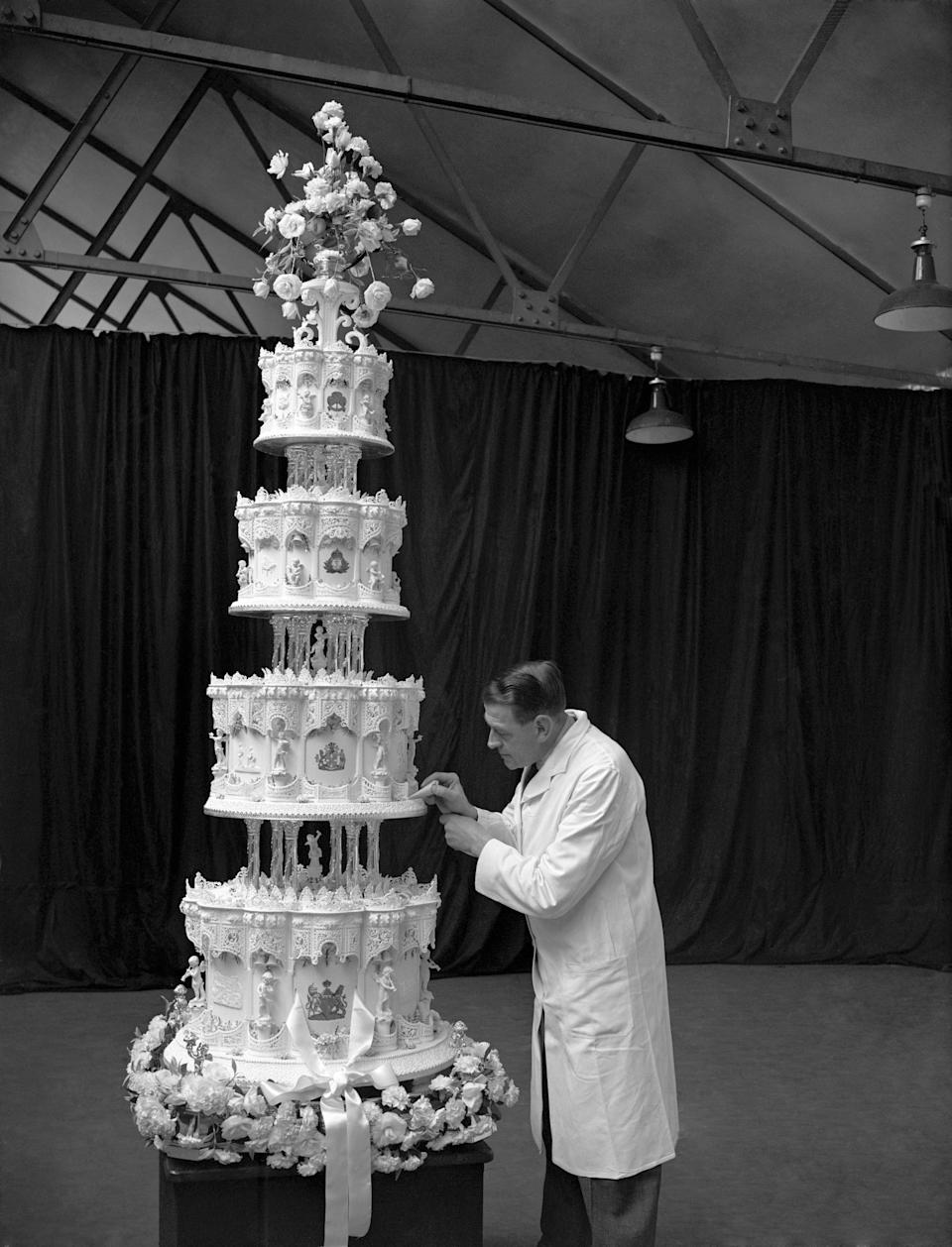 <p>Mr Schur, chief confectioner at McVitie and Price Ltd, was the mastermind behind the incredibly elaborate, 9ft cake baked for the Queen's wedding to Prince Philip back in 1947. As post-war rationing was still underway, the cake's ingredients were flown in from South Africa and Australia – giving the four-tier bake the nickname the '10,00-mile cake.'<em> [Photo: Getty]</em> </p>