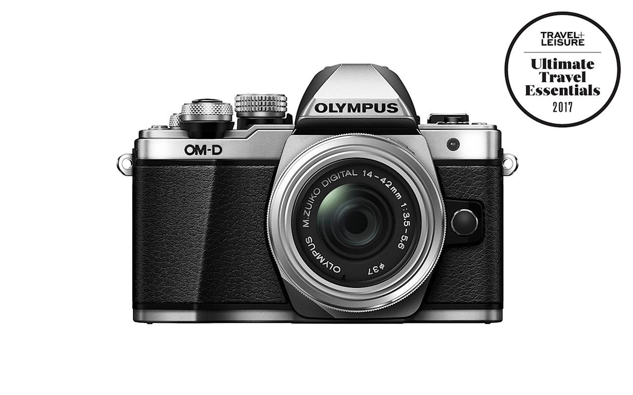 """<p>When your dad retired, did he head straight from the office to the airport to board a flight to anywhere warmer and slower? Now that he's up for wherever his margarita and bottle of sunscreen take him, arm him with the right equipment to document every single moment. This entry-level mirrorless Olympus model (one of our picks in this year's <a href=""""https://www.travelandleisure.com/ultimate-travel-essentials"""" target=""""_blank"""">Ultimate Travel Essentials</a>) offers lots of creative control, but it's easy to use for island hoppers like Dad who can't stop snapping photos of the beach.</p> <p>To buy: <a href=""""https://www.amazon.com/Olympus-Mirrorless-Digital-Camera-14-42mm/dp/B016LMB770//ref=as_li_ss_tl?ie=UTF8&linkCode=ll1&tag=travandleis07-20&linkId=e4b1d3b43bff8dd8d551e50ea2b531b7"""" target=""""_blank"""">amazon.com</a>, $799</p>"""