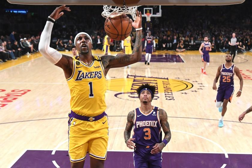 LOS ANGELES, CALIFORNIA FEBUARY 10, 2020-Lakers Kentavious Caldwell-Pope dunks over Suns Kelly Oubre Jr. at the Staples Center Monday. (Wally Skalij/Los Angeles Times)