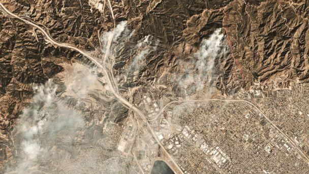 PHOTO: This October 11, 2019, image courtesy of Planet Labs Inc., shows smoke from the Saddleridge Fire about 20 miles north of downtown Los Angeles. (Planet Labs Inc./AFP via Getty Images)