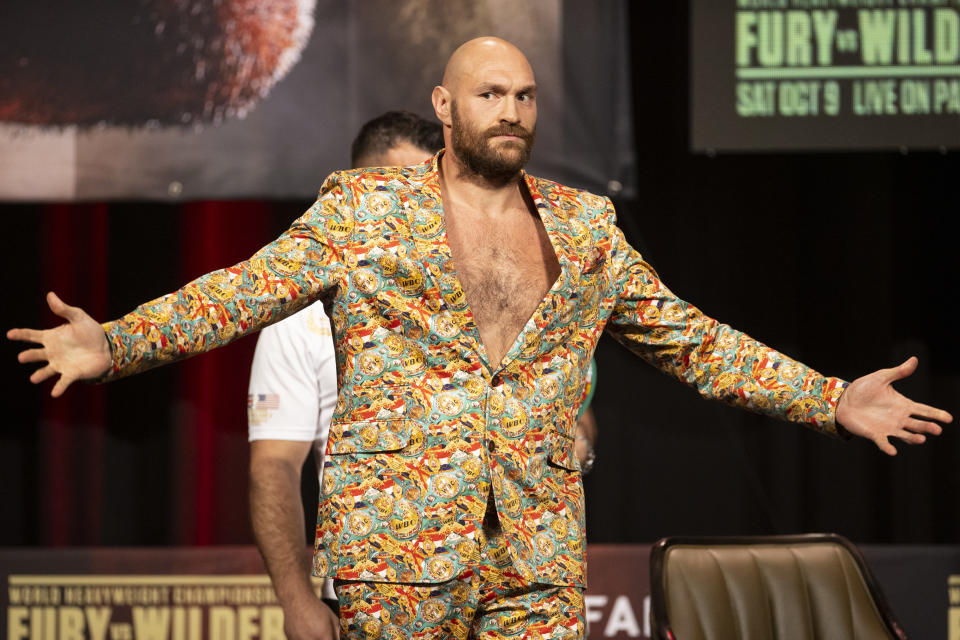 Tyson Fury poses during a news conference for his heavyweight title boxing bout against Deontay Wilder, in Las Vegas on Wednesday, Oct. 6, 2021. (Erik Verduzco/Las Vegas Review-Journal via AP)