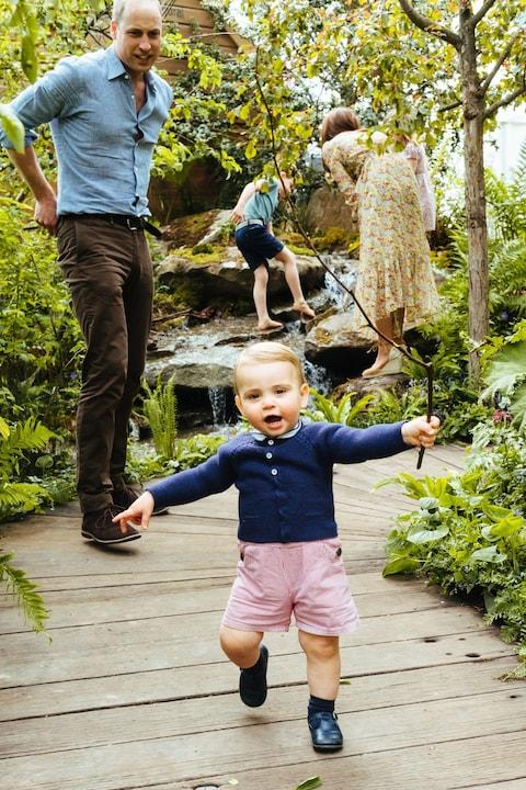 Prince Louis, clutching a stick, takes his first steps on camera - Credit: Matt Porteous