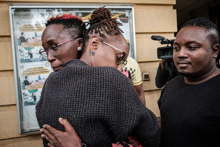 LGBTQ community members and supporters comforted each other after the Kenyan court's verdict refusing to scrap laws criminalising homosexuality (AFP Photo/Yasuyoshi CHIBA)