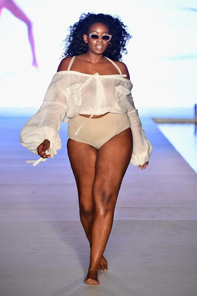 <p>A model walks the runway in a white summer blouse and bikini bottom for the <em>Sports Illustrated</em> swimsuit show during the Paraiso Fashion Fair in Miami at the W South Beach hotel on July 15. (Photo: Alexander Tamargo/Getty Images for Sports Illustrated) </p>