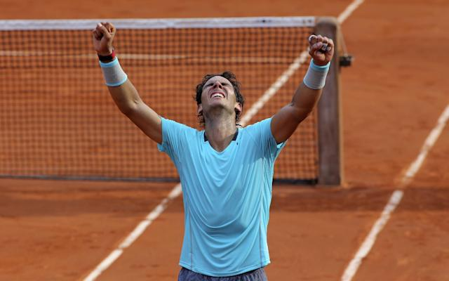 Spain's Rafael Nadal reacts after defeating Serbia's Novak Djokovic in their final match of the French Open tennis tournament at the Roland Garros stadium, in Paris, France, Sunday, June 8, 2014. (AP Photo/Thibault Camus)