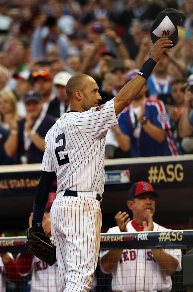 American League shortstop Derek Jeter, of the New York Yankees, waves as he is taken out of the game in the top of the fourth inning of the MLB All-Star baseball game, Tuesday, July 15, 2014, in Minneapolis. (AP Photo/Jim Mone)