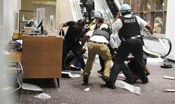 PHOTO:Police officers struggle with a suspected looter in Nordstrom. Looters broke into downtown shops in the early hours of the morning, Chicago, Aug 10, 2020. (RVM/REX via Shutterstock)