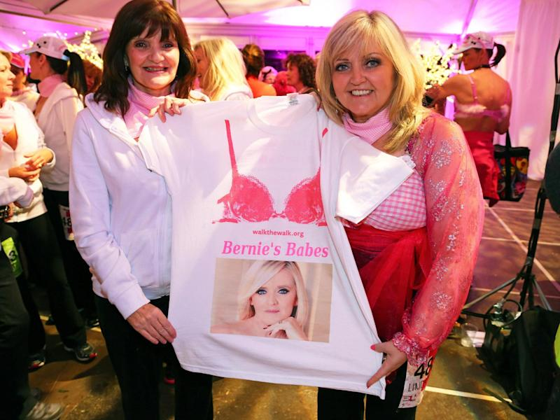 The sisters attend the Walk the Walk Moonwalk charity walk in London on 10 May 2014, holding a T-shirt showing their sister Bernie who died of breast cancer in 2013: Paul Brown/Shutterstock