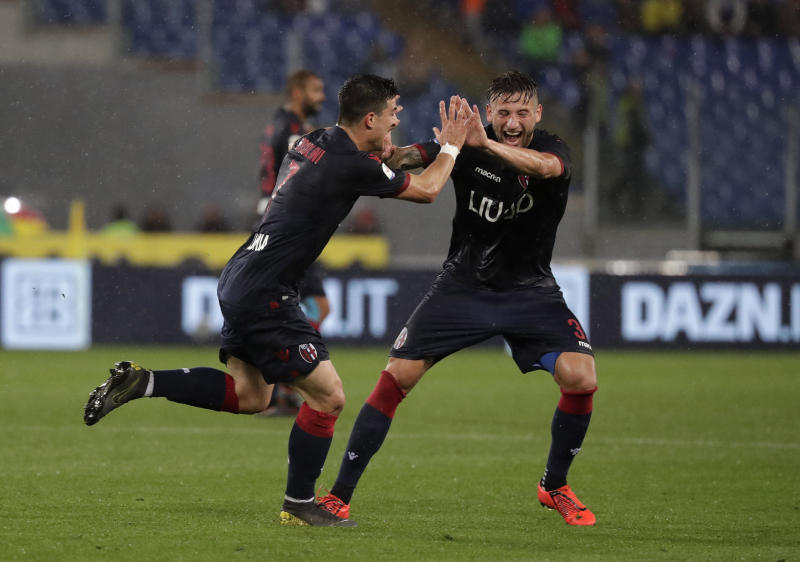 Bologna's Riccardo Orsolini, left, celebrates with Bologna's Giancarlo Gonzalez after scoring his side's third goal during an Italian Serie A soccer match between Lazio and Bologna, at the Olympic stadium in Rome, Monday, May 20, 2019. (AP Photo/Andrew Medichini)