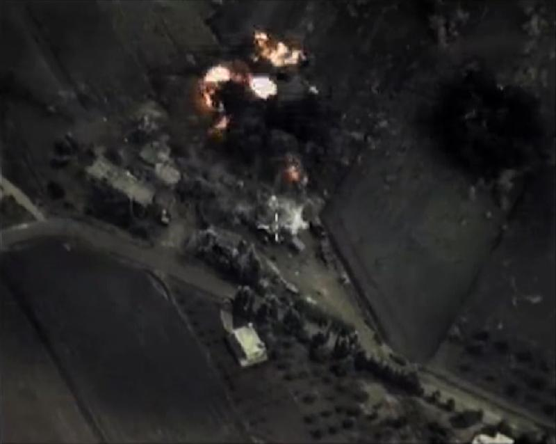 A video grab made on September 30, 2015, shows footage made available on the Russian Defence Ministry's official website, purporting to show an airstrike in Syria