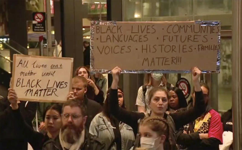 "In this image made from video, protesters hold up placards reading ""Black Lives Matter"" during a peaceful rally in Perth, Australia, Monday, June 1, 2020. Hundreds of demonstrators gathered to protest the death of George Floyd, a black man, who died after being restrained by Minneapolis police officers on May 25. (Channel 10 via AP)"