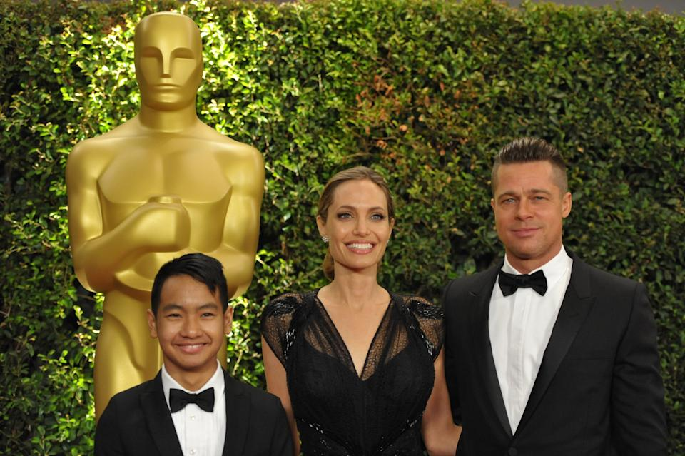 Maddox Jolie-Pitt, Angelina Jolie and Brad Pitt  seen on the red carpet at the 2013 Board of Governors of the Academy of Motion Pictures Arts and Sciences' Governor Awards, on Saturday, Nov. 16, 2013 in Los Angeles (Photo by John Shearer/Invision/AP)