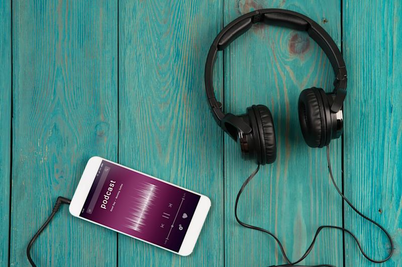 Music online concept - phablet and headphones on the wooden desk
