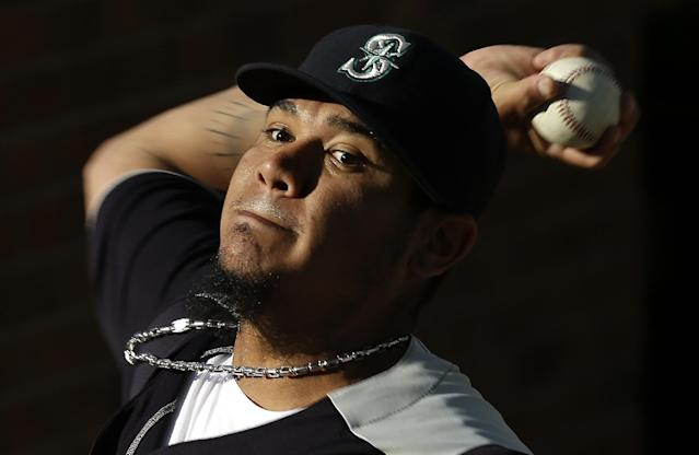 Seattle Mariners starting pitcher Felix Hernandez throws a bullpen session before a baseball game against the Detroit Tigers in Detroit, Monday, Sept. 16, 2013. (Paul Sancya)