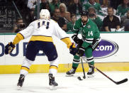 Nashville Predators defenseman Mattias Ekholm, left, defends as Dallas Stars left wing Jamie Benn (14) moves the puck upice in the first period of Game 3 in an NHL hockey first-round playoff series in Dallas, Monday, April 15, 2019. (AP Photo/Tony Gutierrez)