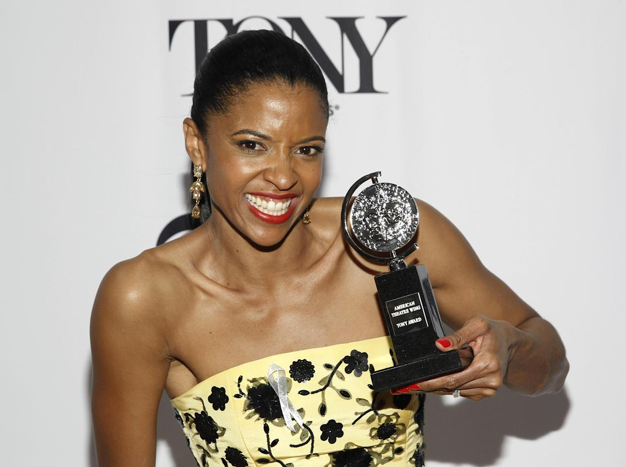 Goldsberry posing with her Tony award for Best Performance by a Featured Actress in a Musical, for Hamilton, in 2016. (Photo: REUTERS/Andrew Kelly)
