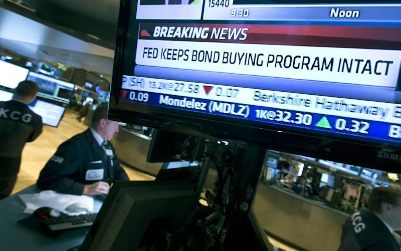A television monitor on the floor of the New York Stock Exchange shows the decision of the Federal Reserve, Wednesday, Sept. 18, 2013. The Federal Reserve decided Wednesday against reducing its stimulus for the U.S. economy, saying it will continue to buy $85 billion a month in bonds because it thinks the economy still needs the support. (AP Photo/Richard Drew)