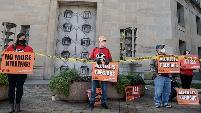 Demonstrators protest federal executions of death row inmates, in front of the US Justice Department in Washington