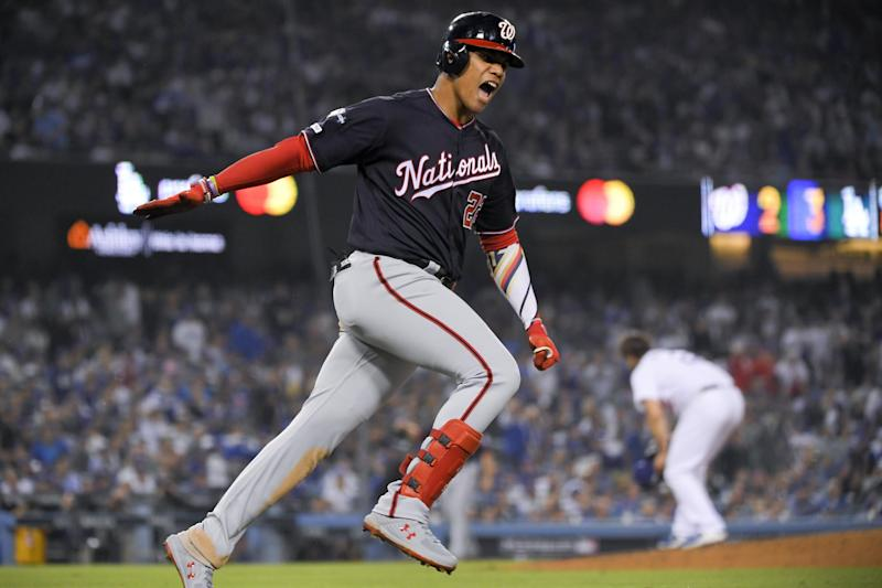 Washington Nationals' Juan Soto celebrates his home run against the Los Angeles Dodgers during the eighth inning in Game 5 of a baseball National League Division Series on Wednesday, Oct. 9, 2019, in Los Angeles. (AP Photo/Mark J. Terrill)