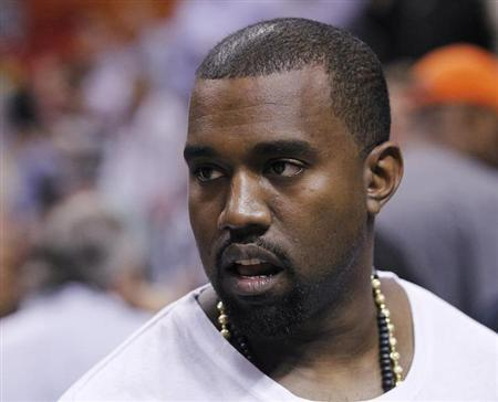 Rap musician West is seen court side as the Miami Heat play the New York Knicks in their NBA basketball game in Miami
