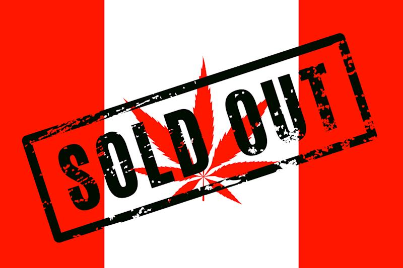 A Canadian flag with a cannabis leaf instead of a maple leaf, and a large stamp across the flag that says, Sold Out.