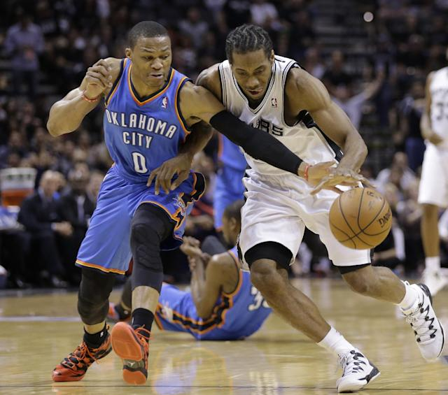 Oklahoma City Thunder's Russell Westbrook (0) and San Antonio Spurs' Kawhi Leonard chase a loose ball during the first half of Game 5 of the Western Conference finals NBA basketball playoff series, Thursday, May 29, 2014, in San Antonio. (AP Photo/Eric Gay)