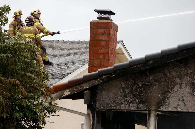 Firefighters work the scene of a deadly plane crash in the residential neighborhood of Yorba Linda, Calif., Feb. 3, 2019. (Photo: Alex Gallardo/AP)