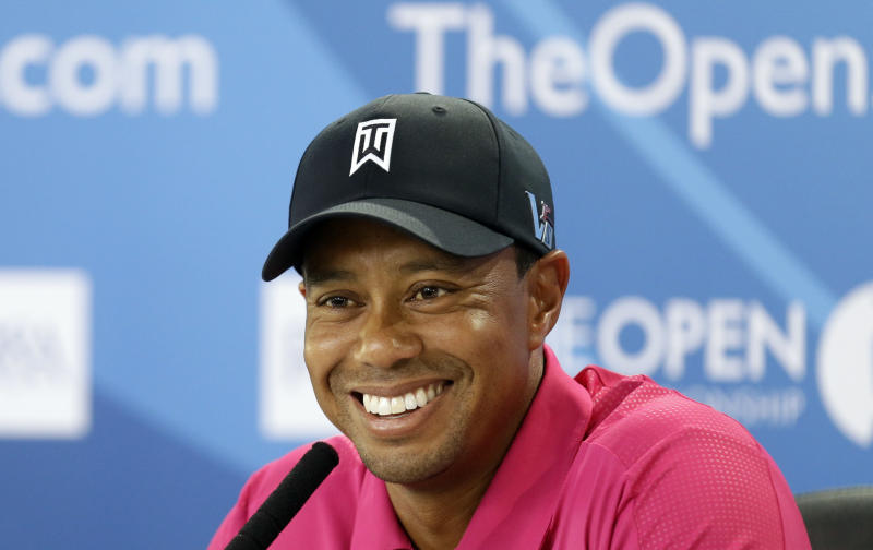 Tiger Woods of the US smiles during a press conference ahead of the British Open Golf Championship at Muirfield, Scotland, Tuesday July 16, 2013. (AP Photo/Alastair Grant)