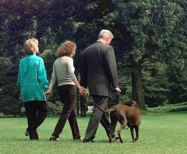 PHOTO: President Clinton, daughter Chelsea and first lady Hillary Rodham Clinton walk with their Labrador 'Buddy' to board Marine One on the South Lawn of the White House in Washington, August 18, 1998. (J. Scott Applewhite/AP, FILE)