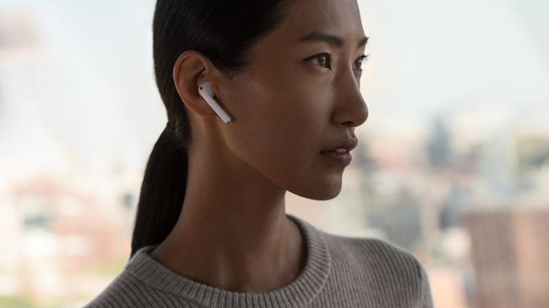 A woman with AirPods in her ears.