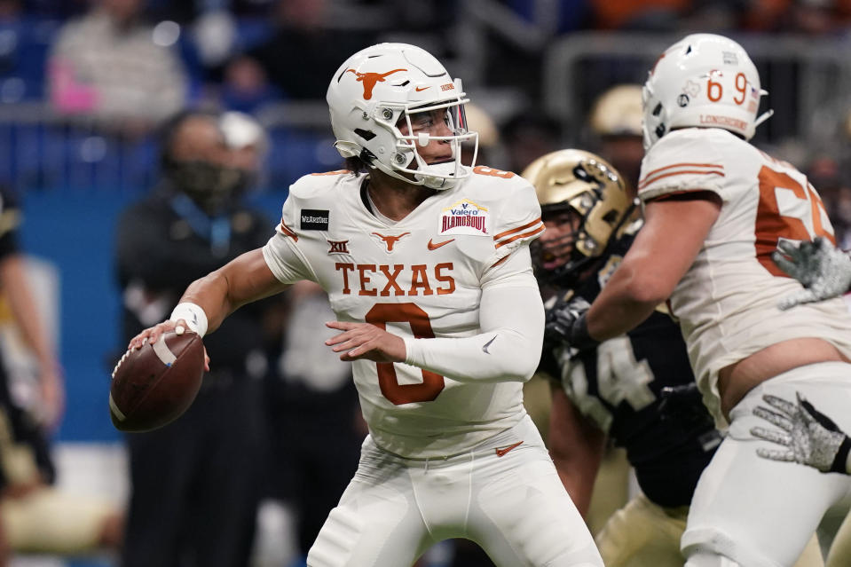FILE - Texas quarterback Casey Thompson (8) looks to pass during the second half of the Alamo Bowl NCAA college football game against Colorado in San Antonio, in this Tuesday, Dec. 29, 2020, file photo. Casey Thompson's Alamo Bowl performance made him look like an easy pick to be starting quarterback at Texas in 2021. But a coaching change from Tom Herman to Steve Sarkisian and the ripe talent of backup Hudson Card has made Saturday's spring scrimmage, and the months leading into the 2021 season, all about one position and who be the starter against Louisiana on Sept. 4. (AP Photo/Eric Gay, File)