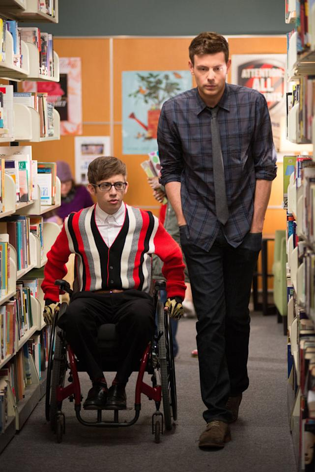 "Artie (Kevin McHale) and Finn (Cory Monteith) chat in the library in the ""Naked"" episode of ""Glee."""