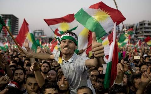 <span>Supporters wave Kurdish flags in Erbil stadium as they wait to hear Kurdistan President Masoud Barzani address crowds ahead of a September referendum on independence</span> <span>Credit: Getty </span>