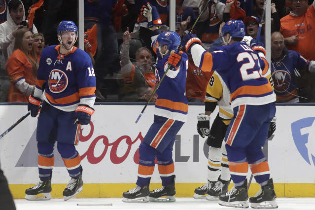 New York Islanders right wing Josh Bailey (12) celebrates his third-period goal with teammates during Game 2 of an NHL hockey first-round playoff series against the Pittsburgh Penguins, Friday, April 12, 2019, in Uniondale, N.Y. The Islanders won 3-1. (AP Photo/Julio Cortez)