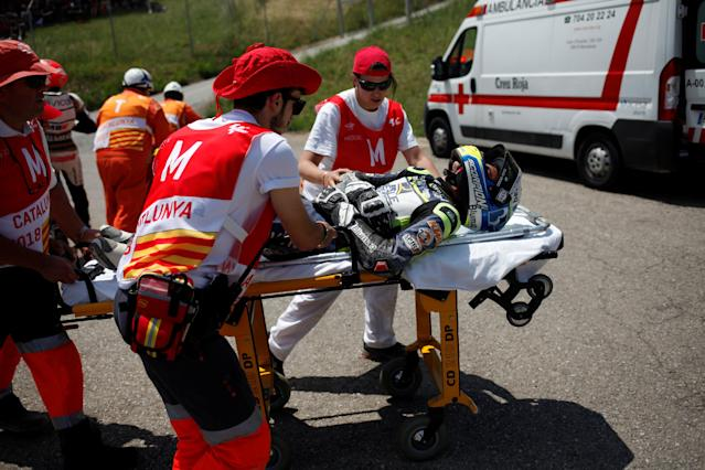 MotoGP - Grand Prix of Catalunya - Circuit de Barcelona-Catalunya, Barcelona, Spain - June 16, 2018 Real Avintia Academy 77's Vicente Perez is stretchered away for medical attention after a fall during moto 3 qualifying REUTERS/Jon Nazca