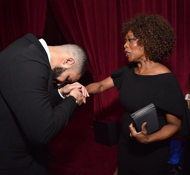 <p>Kiss the ring! Drake bowed down to Alfre Woodard during the Netflix Golden Globes party. (Photo: Kevin Mazur/Getty Images for Netflix) </p>