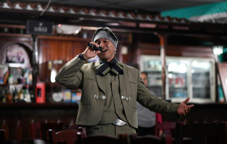 Venezuelan nurse Edgar Fernandez, who works at a state hospital, sings in mariachi costume at a restaurant at the town of El Junquito near Caracas