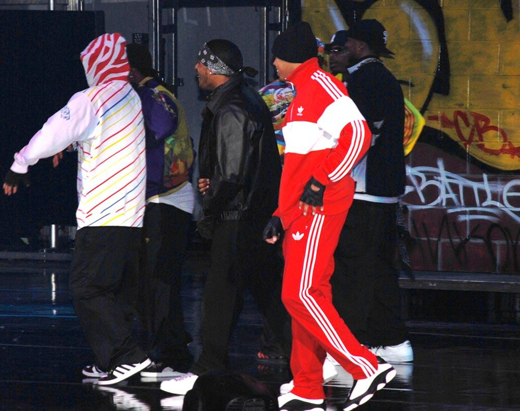 "The 18-year-old behind such hits as ""With You,"" ""Kiss Kiss,"" and ""Run It!"" shows off his breakdancing skills while sporting a red Adidas track suit. Brandon Todd/<a href=""http://www.splashnewsonline.com"" target=""new"">Splash News</a> - January 19, 2008"