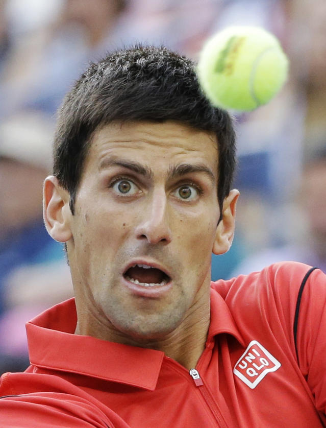 Novak Djokovic, of Serbia, returns a shot to Rafael Nadal, of Spain, during the men's singles final of the 2013 U.S. Open tennis tournament, Monday, Sept. 9, 2013, in New York. (AP Photo/David Goldman)