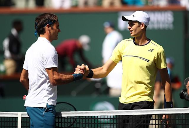 Learning experience: Five-time champion Roger Federer shakes hands with 67th-ranked Hubert Hurkacz after beating the 22-year-old from Poland in the quarter-finals of the ATP Indian Wells Masters (AFP Photo/CLIVE BRUNSKILL)
